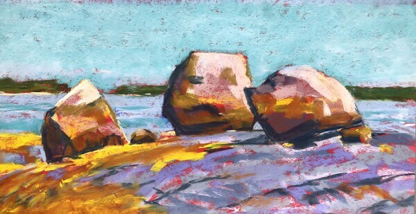 Three colorful boulders with ocean and sky